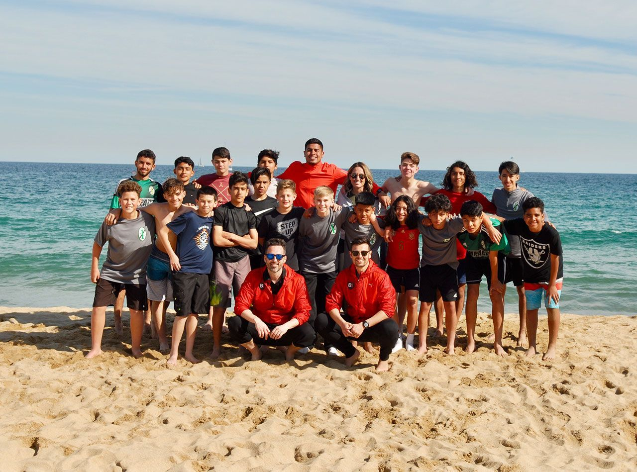 Impact SC Beach Soccer with B1 Staff